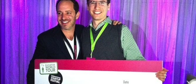 MobileOCT CEO Ariel Beery, right, receives $100,000 investment prize from Philippe Telio, founder and producer of the International Startup Festival and Elevator World Tour.