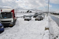 Cars stuck on Route 1, the Jerusalem-Tel Aviv highway, on Sunday morning, after three days of heavy snowfall. Photo by Daniel Cohen/Flash 90.