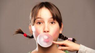Pop that gum-chewing habit to lessen headaches. Image via Shutterstock.com
