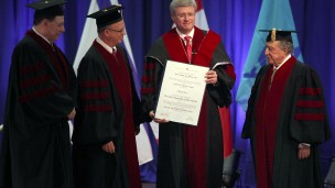 Canadian Prime Minister Stephen Harper is awarded a honorary Doctor of Philosophy degree from Tel Aviv University. Professor Joseph Klafter, President of Tel Aviv University and Professor Aron Shai and David Azrieli look on.  (Photo by Gideon Markowicz/Flash90)