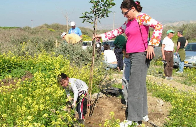 Planting a tree for Tu B'Shvat.