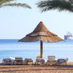 The photo of a beach in Eilat is by Shutterstock.com.
