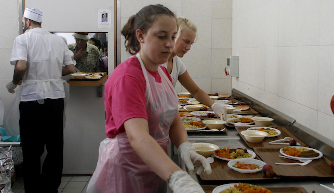 Volunteers at a soup kitchen in Israel. Photo by Lara Savage/Flash 90