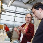 Brandeis biology Prof. Leslie Griffith showing her lab to Noam Ziv of the Technion. Photo by Mike Lovett