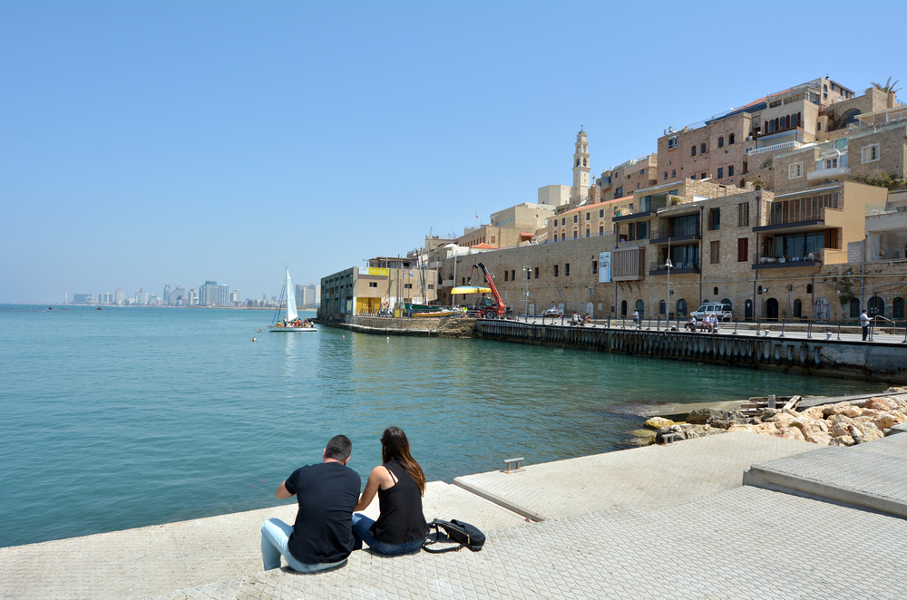 Jaffa Harbor pier is a beautiful place to sit and enjoy the view. Photo via Shutterstock.com