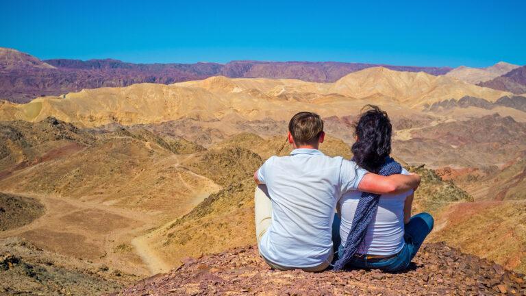 A young couple enjoys desert views near Eilat. Photo via Shutterstock