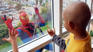 Spiderman swoops in to Schneider Children's Medical Center to say Happy Purim to young patients. (Courtesy of Schneider Children's Medical Center)