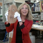 Debby Hershman in her museum lab with one of the ancient masks. Photo by Abigail Klein Leichman