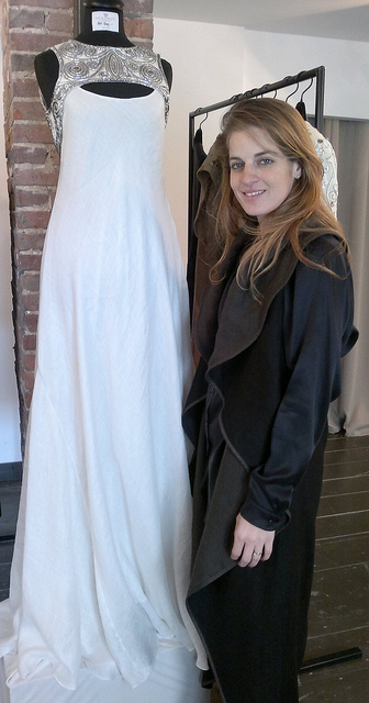 Sharon Tal, wearing an Egg Coat, shows the most expensive item in the collection. Photo by Abigail Klein Leichman