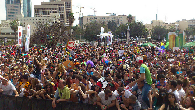 Tel Aviv's Purim street party attracts thousands.