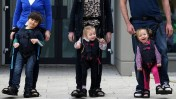 Daniel Smyth, 5, Bethany Watson, 3, and Charlotte Taylor, 3, using a Firefly Upsee to walk with their parent. Photo courtesy of Leckey Firefly