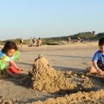 Children build sandcastles at Poleg Beach in Netanya. Photo by Mendy Hechtman/Flash 90