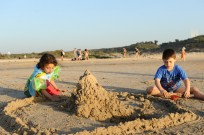 Children build sandcastles at Poleg Beach in Netanya. Photo by Mendy Hechtman/Flash 90