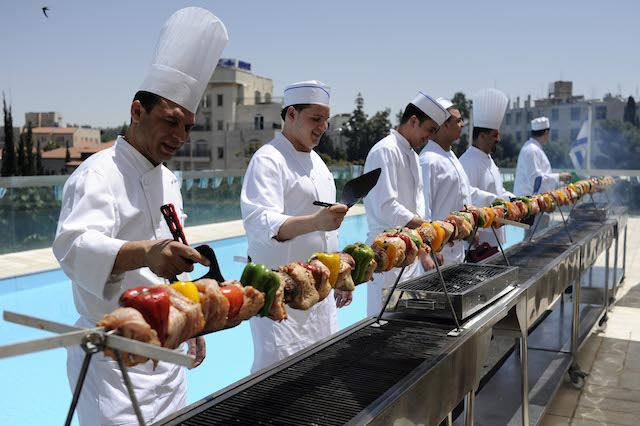 Ahead of Israel Independence Day in 2012, chefs at Jerusalem's Grand Court Hotel constructed an eight-meter barbecue grill to prepare 35 kilograms of meat. Photo by Yoav Ari Dudkevitch/Flash90