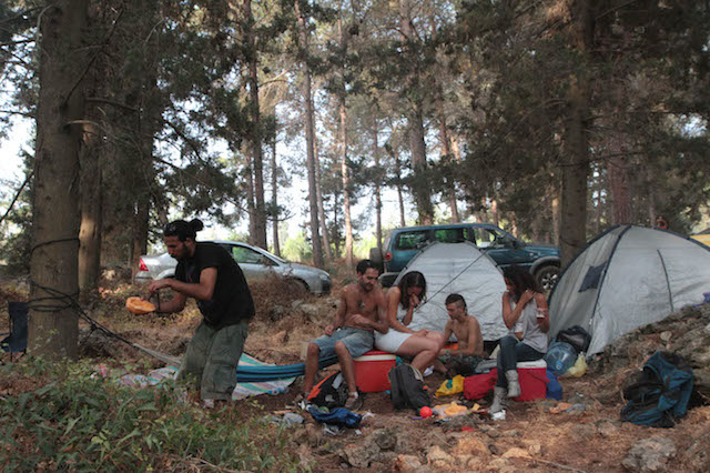 Israelis camping in the Carmel forest. Photo by Alana Perino/Flash90.