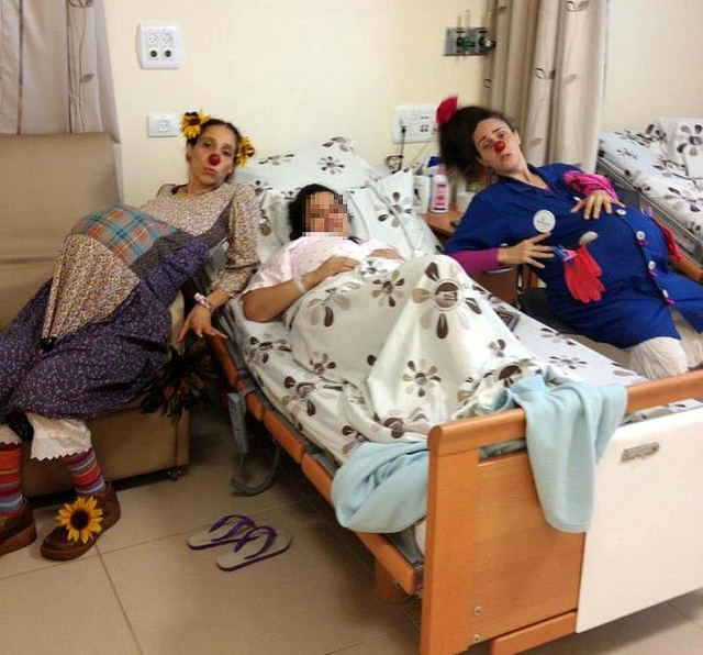 "Shirley Goldstein (""Florina"") and Ayelet Shadmon (""Yula"") with a laboring mother at Poriya Hospital."