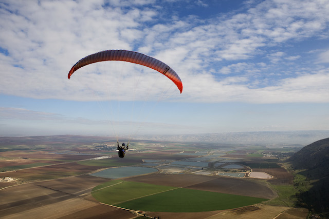 Israelis love extreme adventures, like paragliding over the Jezreel Valley shown in this photo by Matanya Tausig of Flash90.