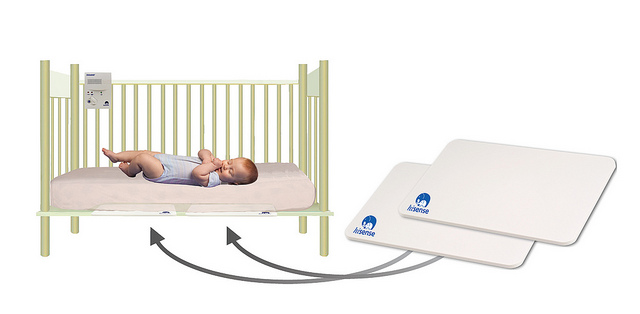 Babysense slips under the crib mattress.