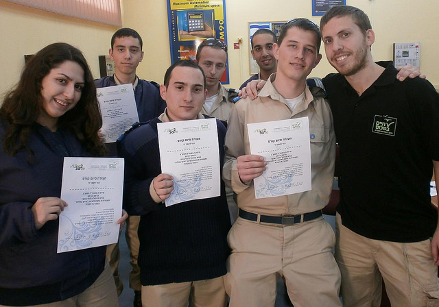 Cadets at Amal Holtz High School in Tel Aviv with their mentor, right.