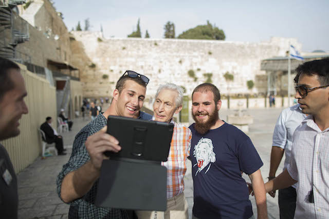The Rolling Stones drummer Charlie Watts stopped for selfies with fans during the band's visit to Jerusalem's Western Wall. Photo by Yonatan Sindel/Flash 90