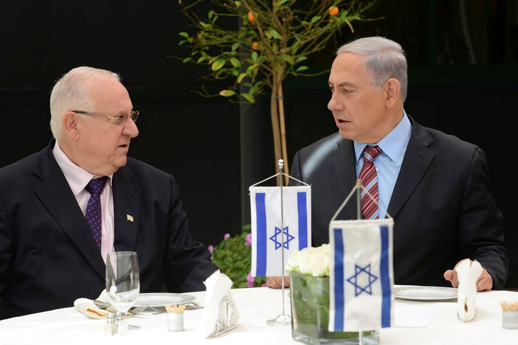 Newly elected president Reuven Rivlin (L) seen with Israeli Prime Minister Benjamin Netanyahu, a day after winning a vote held in the Israeli parliament to become the 10th President of the State of Israel. Photo by Flash90