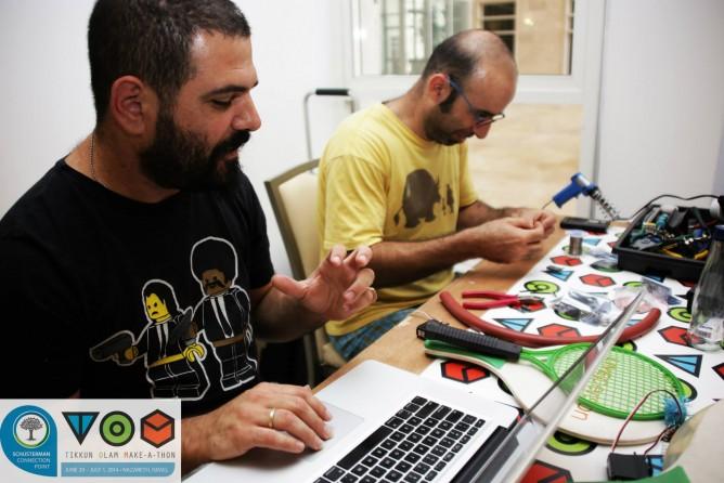 Saron Paz and Zvika Markfeld working on their idea.