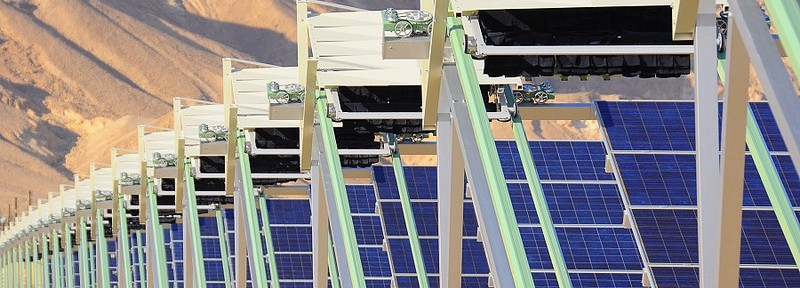 The robots clean dust off 18,200 panels at Ketura Sun every evening.
