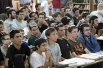 Students of the Mekor Chaim yeshiva in Kibbutz Kfar Etzion, where two of the three kidnapped boys were students, listening to Israeli Minister of Economics Naftali Bennett addressing them on June 16, 2014. (Photo by Gershon Elinson/FLASH90)