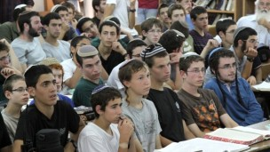 Students of the Mekor Chaim yeshiva in Kibbutz Kfar Etzion, where two of the three kidnapped boys were students, listening to Israeli Minister of Economics Naftali Bennett addressing them on June 16, 2014. (Photo by Gershon Elinson/FLASH90)
