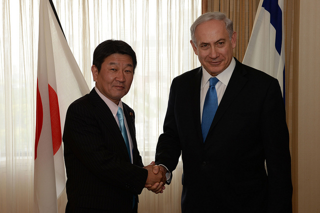 Prime Minister Netanyahu with Japan's Economy Minister, Toshimitsu Motegi, in April 2014. Photo by Kobi Gideon/GPO