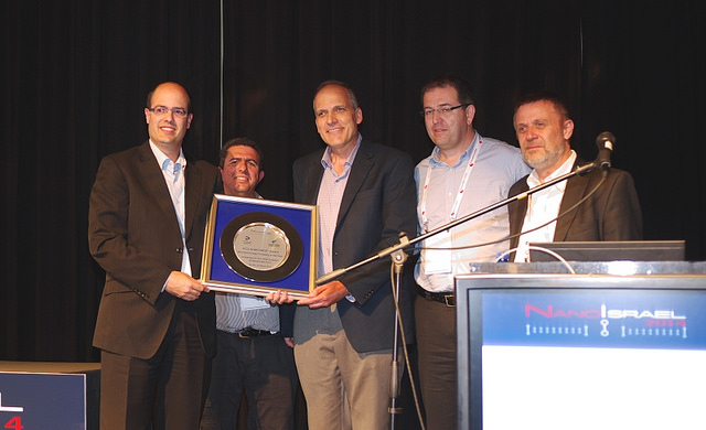 Qlite accepting its award at Nanotech Israel 2014.