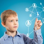 (kids social media) Connecting kids safely to social media. Image via Shutterstock.com