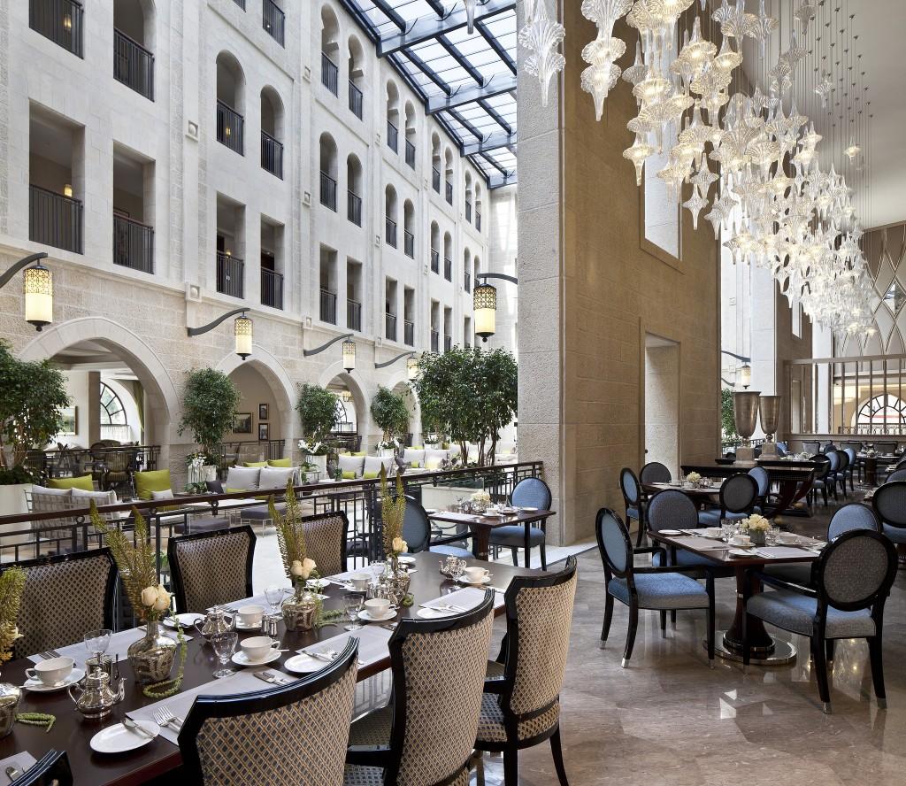 Palace Restaurant overlooking the atrium. Photo courtesy of the Waldorf Astoria Jerusalem