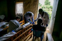 Dr. Lobel collecting samples from Ebola survivors in Uganda.