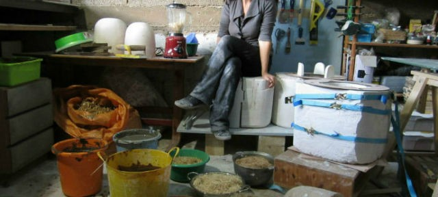 Adital Ela surrounded by natural materials in her studio.