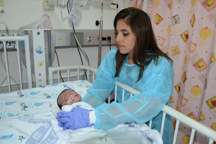 Irena Nosel caring for a baby from Gaza at Israel's Wolfson Medical Center.