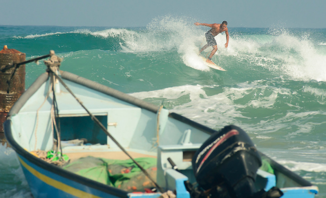 Solan's Arab-Israeli friend Barak surfing the waves. Photo by Uri Magnus