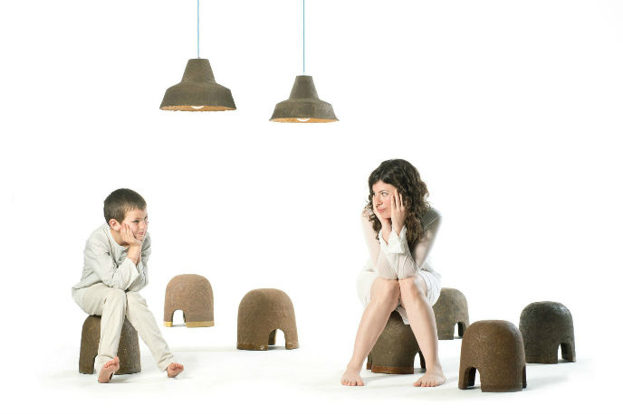 The artist's friend Maayan and her nephew, Yonatan, sit on Terra stools. Photo by Shay ben Efrayim