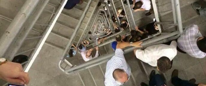 Employees at the Azrieli Center in Tel Aviv go to the stairs to take shelter