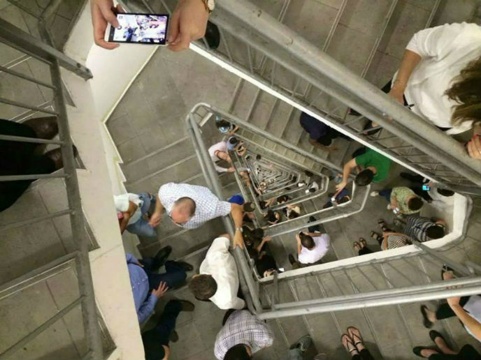 Employees at the Azrieli Center in Tel Aviv go to the stairs to take shelter.