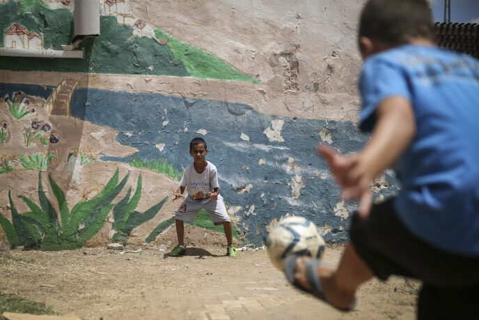 Children playing outside a bomb shelter that also functions as a children's summer club in the southern Israeli town of Kiryat Malachi, July 14, 2014. Photo by Hadas Parush/FLASH90