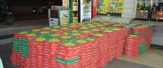 1,000 pizzas ready to be delivered to soldiers. Photo by Gedaliah Blum
