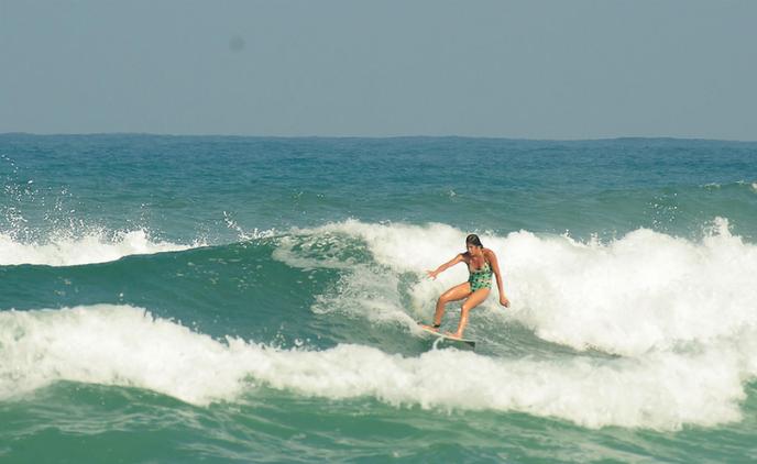 Nitzan Solan surfing with her Arab friends in an Arab village on the Israeli Mediterranean coast. Photo by Uri Magnus, http://polmagnus.com.