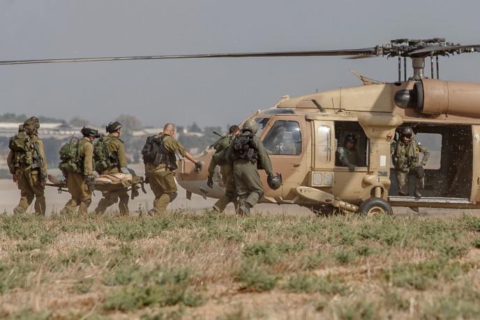 An injured Israeli soldier is evacuated by helicopter from near the Israeli border with Gaza Strip on July 21, following heavy fighting. Photo by Flash90.
