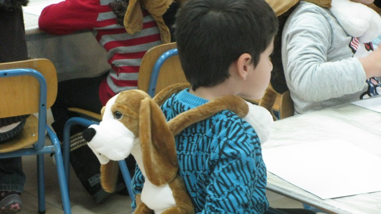 Children in Sderot being hugged by Hibuki. Photo courtesy of JDC-Israel