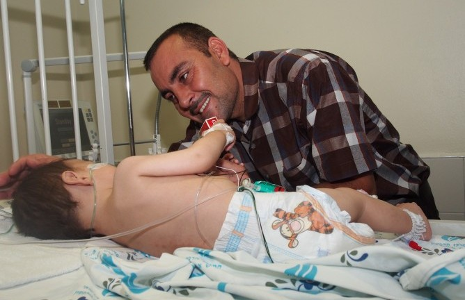 Wisam and his dad at Wolfson Medical Center.