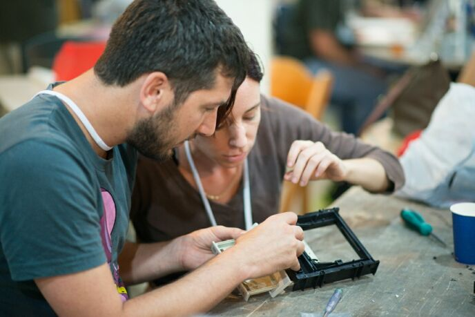 Matan Melamed and Ella Miller working on their useless coffee printer last year.