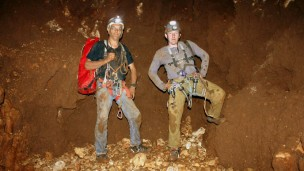 Vladimir Buslov and Yuri Lisovic from the Hebrew University's Cave Research Unit stand 187 meters below ground at the bottom of Israel's deepest cave. (Photo: Boaz Langford, Hebrew University Cave Research Unit)