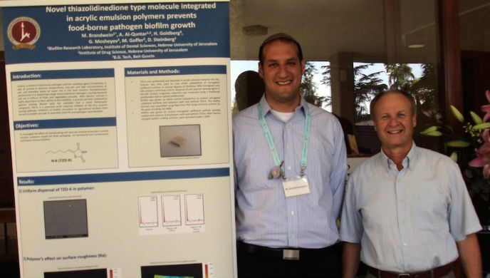 Michael Brandwein, left, and his mentor Prof. Doron Steinberg from the Hebrew University's Biofilm Research Laboratory.
