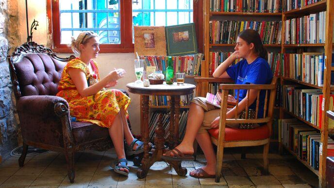 Patrons relax at the iconic café Tmol Shilshom.